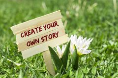 Create your own story. On wooden sign in garden with white spring flower royalty free stock images