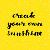 Create your own sunshine. Brush lettering. Create your own sunshine. Brush hand lettering. Inspiring quote. Motivating modern calligraphy. Can be used for home Stock Photos