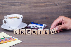 Created.Wooden letters on dark background Stock Photo