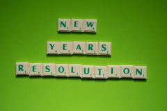 Created words of `new years resolution` on the green background. Created words of `new years resolution` with the letters on the green screen background royalty free stock image