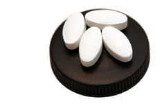 Creatine tablets. Four pills on black cover, isolated stock photos