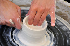 Creating Artistic Pottery. Turning Clay Cup on Potters Wheel Royalty Free Stock Images
