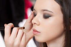 Creating beautiful makeup. Royalty Free Stock Photography