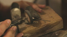Creating brass jewelry in a workshop stock footage