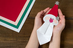 Creating a Christmas decoration for table setting. Step 9 Stock Images