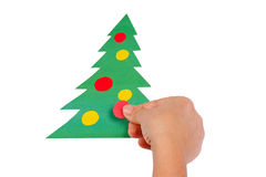Creating Christmas tree of colored paper Stock Photo