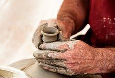 Creating an earthen jar Royalty Free Stock Image