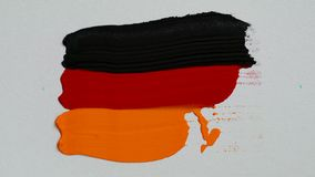 Creating a flag of Germany with acrylic paints and palette knife. Creative concept stock footage