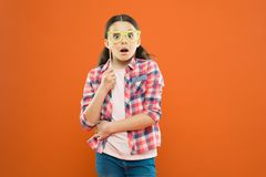 Creating fun with surprise photobooth. Surprised girl holding prop glasses on orange background. Little child looking. With surprise. Eye opening surprise. It stock photos