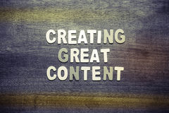 Creating Great Content. Text arranged with wood letters on wood texture Stock Photo