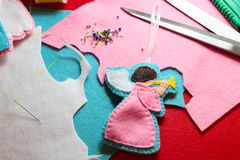 Creating of handicraft felted angel figure Royalty Free Stock Photo