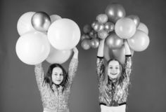 Creating happy moments. Little girls having fun with colorful balloons. Happy children playing with air balloons. Using royalty free stock photo