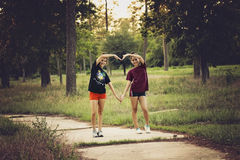 Creating a heart. Teenagers creating a heart in a forrest in Houston, Texas, USA Stock Images