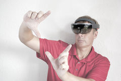 Creating holograms with smart glasses. Man is working with smart glasses. creating virtual reality. mixing real and dream. position of hand gesture interacting Royalty Free Stock Images