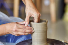 Creating jar or vase of clay. Woman hands, potter`s wheel Stock Image