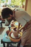 Creating a jar or vase of white clay close-up. Master crock. Stock Photo