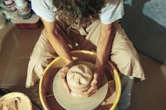 Creating a jar or vase of white clay close-up. Master crock. Stock Image