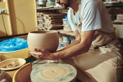 Creating a jar or vase of white clay close-up. Master crock. Stock Photography