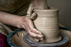 Creating a jar or vase of white clay close-up Royalty Free Stock Photography