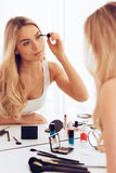 Creating long lashes. Stock Images