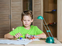 Creating the model plane. Happy boy making aircraft model. Hobby concept. Stock Photo