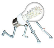 Innovation. Small robot created with screws, nuts and a led light bulb. It represent the creation of a new idea or concept Royalty Free Stock Images