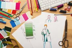 Hand drawn sketches for new fashion collection. Creating new fashion collection background. Hand drawn sketches of clothes, smartphone with color swatches on Stock Photos