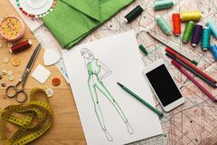 Hand drawn sketches for new fashion collection. Creating new fashion collection background. Hand drawn sketches of clothes, smartphone, color swatches and Stock Images