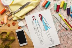 Hand drawn sketches for new fashion collection. Creating new fashion collection background. Hand drawn sketches of clothes, smartphone, color swatches and Stock Photos