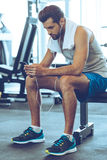 Creating new playlist for his new work out. Stock Images