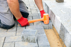 Creating a pavement. Close up. Royalty Free Stock Image