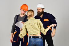 Creating perfection. Construction workers team. Professional people working on construction design. Group of. Constructing engineers and architects at work. Men stock images