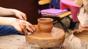 Creating a pot on a potter's wheel. stock video footage