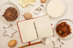 Creating a Recipe. Directly above view of blank recipe book with various ingredients. Add own text Royalty Free Stock Photos
