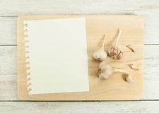 Creating a Recipe. Directly above view of notebook and cutting board with raw vegetables around it Royalty Free Stock Photo