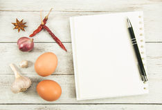Creating a Recipe. Directly above view of notebook and raw vegetables around it Stock Photos