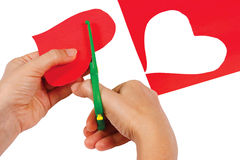 Creating red heart of colored paper Stock Images