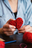 Creating red woolen heart Stock Image