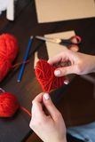 Creating red woolen heart Royalty Free Stock Photography