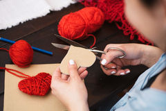 Creating red woolen heart Royalty Free Stock Images