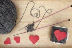 Creating a romantic mug warmer Royalty Free Stock Photo