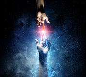 When creating something unique . Mixed media. Close up of human hands touching with fingers in space royalty free stock photo