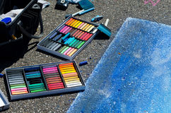 Creating street art. Tools of the trade... pastels are used to create art on the street, using actual road instead of canvas or paper. this is part of a new Stock Image