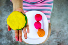 Colorful  play dough on hand. Creating toys from play dough, Homemade toy Royalty Free Stock Image