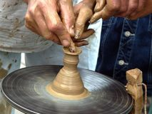 Creating vase. Artist teaches to create a small ceramic vase. pottery royalty free stock photos