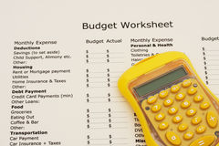 Creating your budget. A budget worksheet with a calculator, Creating your budget Stock Photos