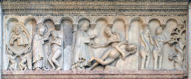 Creation Of Adam and Eve, Temptation. Relief by Wiligelmo, Modena Cathedral, Italy royalty free stock image
