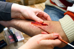Creation of an artificial wound Royalty Free Stock Images