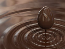 Creation of the chocolate egg. Computer generated image of a chocolate egg into a chocolate cream Royalty Free Stock Photo