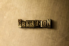 CREATION - close-up of grungy vintage typeset word on metal backdrop. Royalty free stock - 3D rendered stock image.  Can be used for online banner ads and Stock Image